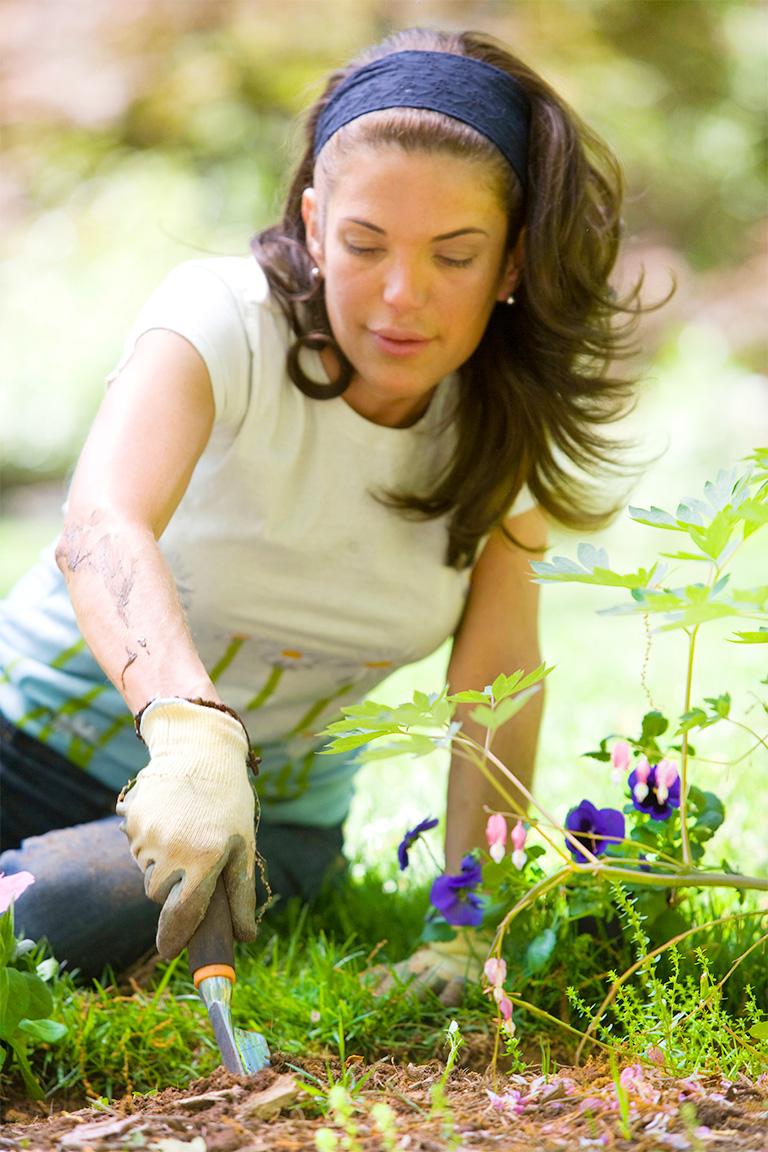 woman gardening outdoors